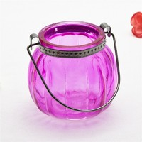 supply of colored pumpkin machine made glass candle holder with wire handler