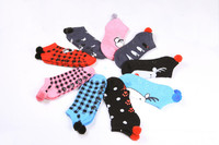 Women's 144N full cushion sport low cut socks with pom pom and with non-skids