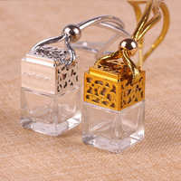 Square shape metal cap handing empty car perfume bottles