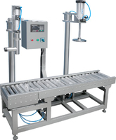 Paint drum filling and capping machine