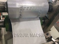 Paper napkin machine